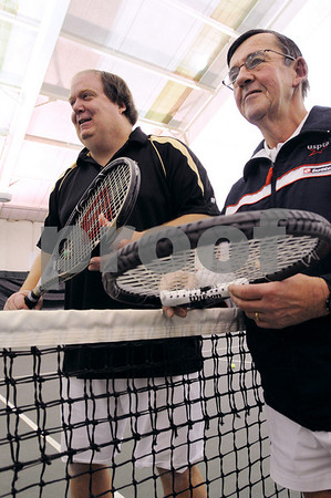 Salem:<br /> John Fox, left, assistant pro, stands at the net with John Foley, the pro, inside the club. John Foley is having the North Shore Tennis & Squash Club named after him. <br /> Photo by Ken Yuszkus/Salem News, Tuesday,  February 10, 2009.