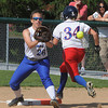 Danvers:<br /> Danvers' first baseman Devyn Downs gets the throw but the Tewksbury player is safe during the Tewksbury at Danvers High softball state tournament game.<br /> Photo by Ken Yuszkus/Salem News, Thursday, May 31, 2012.
