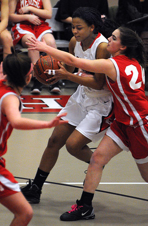 Salem:<br /> Salem's Alix Bryant is covered by a Melrose player but still manages to get a shot at the basket during the Melose at Salem High girls basketball state tournament game.<br /> Photo by Ken Yuszkus/Salem News, Tuesday,  February 28, 2012.
