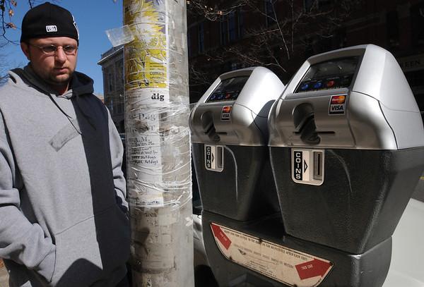 "Salem:<br /> Matthew Bernier looks toward the new parking meter after parking on Washington Street in Salem. Salem has 50 new ""smart"" parking meters downtown that accept credit cards. <br /> Photo by Ken Yuszkus/Salem News, Tuesday,  March 6, 2012."