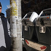 "Salem:<br /> Matthew Bernier looks toward the new parking meter after parking on Washington Street in Salem. Salem has 50 new ""smart"" parking meters downtown that accept credit cards. <br /> Photo by Ken Yuszkus/Salem News, Tuesday,  March 6, 2012."