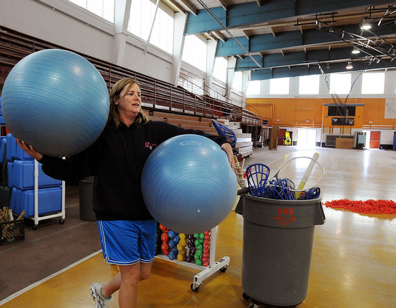 Beverly:<br /> Annie Flaherty, of the Wellness Department, moves some of the equipment in the fieldhouse at Beverly High School. People are cleaning out the field house before the Farewell to the Fieldhouse dance on Friday.<br /> Photo by Ken Yuszkus/Salem News, Wednesday, April 21, 2010.