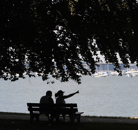 Salem:<br /> A couple look at the harbor from a bench at Salem Willows.<br /> Photo by Ken Yuszkus/Salem News, Monday, August 1, 2011.