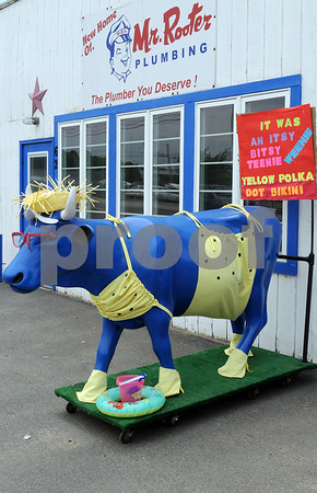 Salem:<br /> A blue cow stands in front of 62 Jefferson Avenue. The cow was won at a charity auction. The people at that address dress it up throughout the year and it's become a bit of a local landmark.<br /> Photo by Ken Yuszkus/Salem News, Friday, June 26, 2009.
