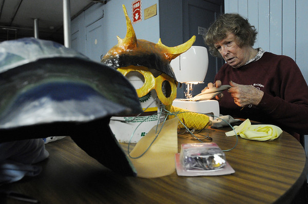 Beverly:<br /> Margo Jones is sewing costumes in the basement of the GAR Hall , as she has done for years, to be used in the Grand Procession of the annual Beverly's New Year celebration on Friday.<br /> Photo by Ken Yuszkus/Salem News, Wednesday,  December 29, 2010.