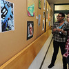 Salem:<br /> Yasmin Nicholson, left, and Matty Soto, both seniors, veiw the art on the hallway wall during the Salem High School annual Deck The Halls Art Exhibit at the shool. Students showcased their photography, graphic design, drawing, painting, sculpture, tv production/digital media, and woodworking.<br /> Photo by Ken Yuszkus/Salem,  News, Wednesday,  December 22, 2010.