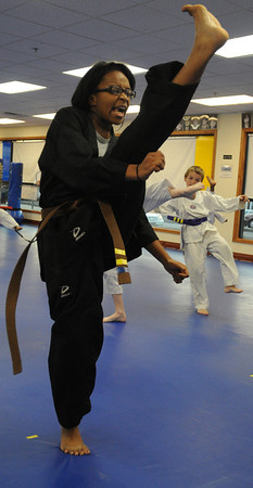 Beverly:<br /> Rosemary Wilkinson during practice of the childrens all belt class at DW Kim US Tae Kwon Do studio on Friday.<br /> Photo by Ken Yuszkus/Salem News, Friday, December 2, 2011.