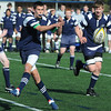 Danvers:<br /> St. John's Prep  Brian Garey passes the ball during the Malden Catholic at St. John's Prep rugby game.<br /> Photo by Ken Yuszkus/Salem News, Thursday, April 15, 2010.