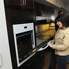 Beverly:<br /> Andrea Jones, on the Greater Beverly YMCA board and of Beverly Bootstraps, tours the kitchen at 9 Mill Street before the ribbon-cutting ceremony to mark completion of first phase and beginning of second phase of the Holcroft Park Homes development.<br /> Photo by Ken Yuszkus/Salem News, Friday, April 13, 2012.