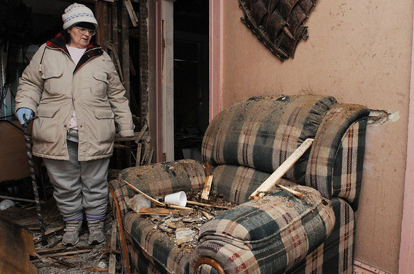 Salem:<br /> Mary Ahearn looks toward a chair that was damaged as the result of the fire in her home at 4 Buffum Street on December 18.<br /> Photo by Ken Yuszkus/Salem News, Wednesday, December 30, 2009.