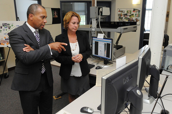 Ipswich:<br /> Governor Deval Patrick speaks with Stephanie Pearsall of EBSCO Publishing, while she explains the scanning process at EBSCO Publishing. The governor was at EBSCO Publishing to celebrate the company's expansion and the creation of 90 new jobs.<br /> Photo by Ken Yuszkus/Salem News, Wednesday, September 14, 2011.