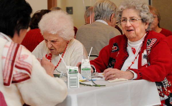 Beverly:<br /> From left, Myo Brady, Mary Femino, and Peggy Wilson converse during the Valentine's Day party at the Beverly Senior Center on Tuesday.<br /> Photo by Ken Yuszkus/Salem News, Tuesday, February 14, 2012.