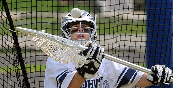 Danvers:<br /> Nick Triano, St. John's Prep lacrosse goalie, practices defending the net during half time at a game at St. John's Prep.<br /> Photo by Ken Yuszkus/Salem News, Thursday, April 22, 2010.