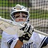 Danvers:<br /> Nick Triano, St. John's Prep lacrosse goalie, practices defending the net during half time at a game at St. John's Prep.<br /> Photo by Ken Yuszkus/Salem News, Thursday, April 22, 2010.