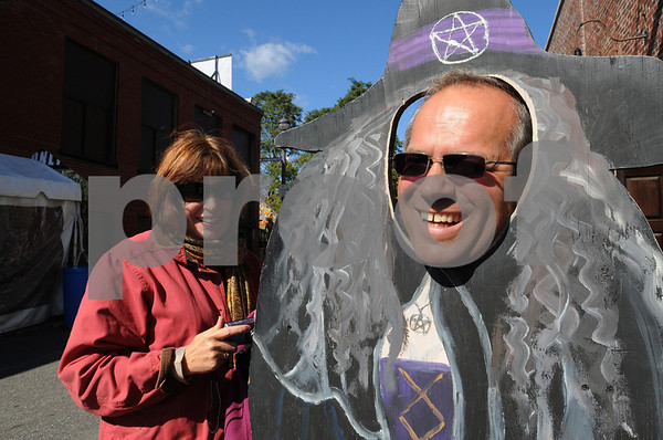 Salem:<br /> Maryann Ouillette laughs after taking her husband, David's photo as he pokes his head through a painted cutout of a witch.<br /> Photo by Ken Yuszkus/Salem News, Wednesday October 14, 2009.