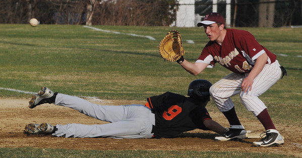 Beverly:<br /> Beverly's Anthony DiOrio gets back safe to first as the ball is thrown to Newburyport's Ryan O'Connor during the Newburyport at Beverly baseball game at Cooney Field.<br /> Photo by Ken Yuszkus/Salem News, Monday, April 11, 2011.