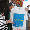 Salem:<br /> Ali Aujali, ambassador from the embassy of Libya in Washington, D.C., receives a t-shirt from Maureen Banks, president and CEO of Spaulding Rehabilitation Hospital, after his speech praising the hospital staff who treated the war wounded from Libya.<br /> Photo by Ken Yuszkus/Salem News, Monday, May 14, 2012.