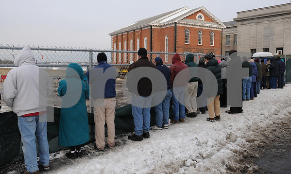 Salem:<br /> Spectators wait patiently in the cold to watch the First Baptist Church being moved.<br /> Photo by Ken Yuszkus/Salem News, Friday January 2, 2009.
