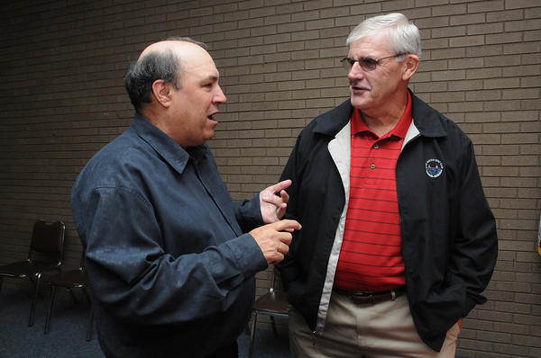 Beverly:<br /> Mike Grenier, left, speaks with Bob Geswell, former athletic director at Salem High School, during Mike's retirement reception at the Salem News on Thursday evening.<br /> Photo by Ken Yuszkus/Salem News, Thursday, September 8, 2011.