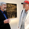 Beverly:<br /> Gordon Arnold, left, and Rob Roy, are two professors from Montserrat who recently curated a show in the art gallery that is based on their conversations over the years about the role of art in depicting world events. <br /> Photo by Ken Yuszkus/Salem News, Friday, August 19, 2011.