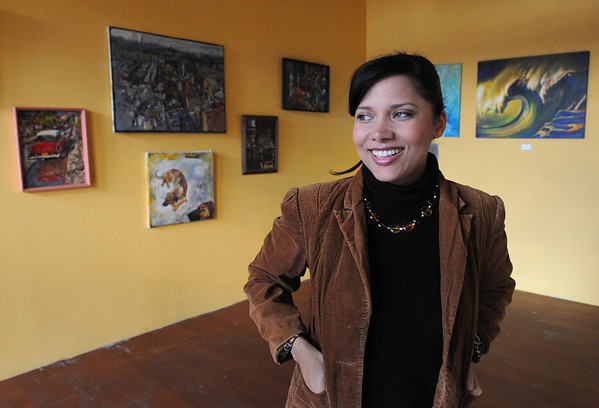 Salem:<br /> Katherine Montero, director of Global Deeds Foundation, Inc., stands in the newly opened art gallery called Artropoly.<br /> Photo by Ken Yuszkus/Salem News, Wednesday, November 30, 2011.