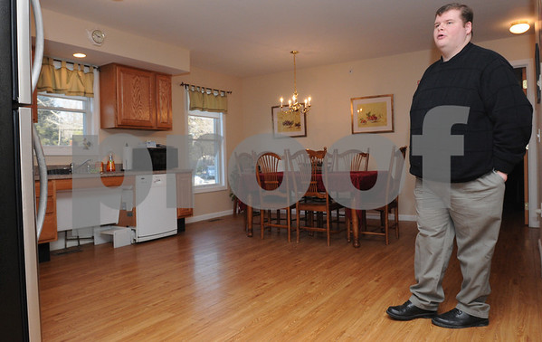 Beverly:<br /> Justin Devoe, program director at the Alzheimer group home, stands in one of the kitchen. The home uses Alzheimers-specific design elements in the home.<br /> Photo by Ken Yuszkus/Salem News, Tuesday,  February 17, 2009