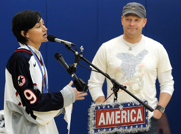 Peabody:<br /> Sandra Whyte Sweeney, left, former Olympic silver medalist in hockey, gives Tim Thomas, the Bruins' goalie and one of the goalies for the USA Olympic Team, helpful suggestions while at the Olympics. The assembled students and faculty at the Covenant Christian school gave him a send off at the school.<br /> Photo by Ken Yuszkus/Salem News, Wednesday, February 3, 2010.
