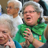 Beverly:<br /> Cynthea Michaels sings and claps to the music of Julie Dougherty and accompanied by Woody Woodward during the St. Patrick's Day party at the Beverly Senior Center.<br /> Photo by Ken Yuszkus/Salem News, Thursday,  March 15, 2012.