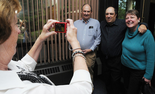 Beverly:<br /> From left, Eileen Grenier, wife of Mike Grenier, takes photos of Tom Clark, who worked at the Beverly Times, Mike Grenier, and Tom's wife, Nancy Clark, during Mike's retirement reception at the Salem News on Thursday evening.<br /> Photo by Ken Yuszkus/Salem News, Thursday, September 8, 2011.