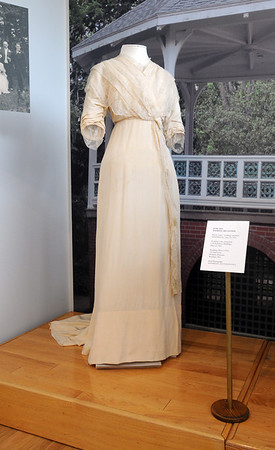 Beverly:<br /> Barbara Bourdo designed the displays for the historical exhibit about the Gold Coast summer houses for the rich that have become buildings at Endicott college. The display in the background is a 1916 wedding dress loaned by the Wenham Museum.<br /> Photo by Ken Yuszkus/Salem News, Monday, February 14, 2011.