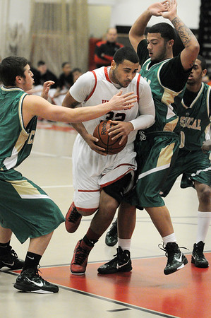 Salem:<br /> Salem's Antonio Reyes gets squeezed at the Lynn Classical at Salem boys basketball game.<br /> Photo by Ken Yuszkus/Salem,  News, Tuesday,  December 21, 2010.