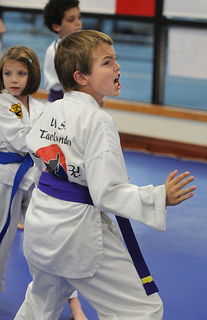 Beverly:<br /> Nathan Maggiacomo during practiice of the childrens all belt class at DW Kim US Tae Kwon Do studio on Friday.<br /> Photo by Ken Yuszkus/Salem News, Friday, December 2, 2011.