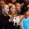 "Peabody:<br /> Front row from left, Angela Duda, her sister, Jessica, and Sadie Martinez-Portillo, 1st graders, sing ""Thanksgiving"" during the Fall Concert presented by the 1st and 2nd graders at the McCarthy Memorial Elementary School on Wednesday morning. <br /> Photo by Ken Yuszkus/Salem News, Wednesday, November 23, 2011."