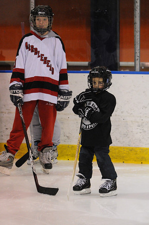 Salem:<br /> Molly Depew, left, works with Tyler Quigley at the Marblehead High School girls hockey youth clinic at Salem State University. The players worked with local female youths on Thursday evening.<br /> Photo by Ken Yuszkus/Salem News, Thursday, February 24, 2011.
