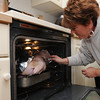 Beverly:<br /> Lyn Ego checks the turkey she just placed in the oven early Thanksgiving morning before she goes to the Salem at Beverly football game at Hurd Stadium to see her son Alex Ego play.<br /> Photo by Ken Yuszkus/Salem News, Thursday, November 25, 2010.
