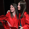 Salem:<br /> Graduates Cassandra Geezil, left, and Jennifer Jendraszek hug when they meet in the foyer of Salem High School before the graduation.<br /> Photo by Ken Yuszkus/Salem News, Friday, June 3, 2011.