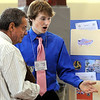 Boxford:<br /> David Donavel, left, one of the judges, speaks to Derek Grammer, freshman, about his project during the Annual Architecture Fair.<br />  at Masconomet High School.<br /> Photo by Ken Yuszkus/Salem News, Thursday, May 13, 2010.