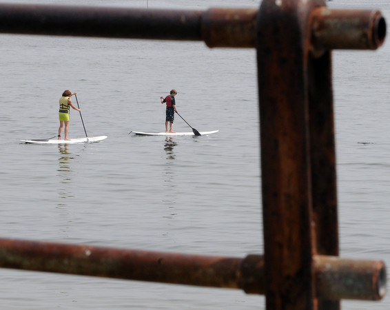 Beverly:<br /> Two paddle boarders paddle past Independence Park on the calm ocean Thursday afternoon.<br /> Photo by Ken Yuszkus/The Salem News, Thursday, August 23, 2012.