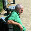 Beverly:<br /> Ken Menesale of Beverly sits in the sun on a bench at Dane Street Beach.<br /> Photo by Ken Yuszkus/The Salem News, Wednesday, August 8,  2012.