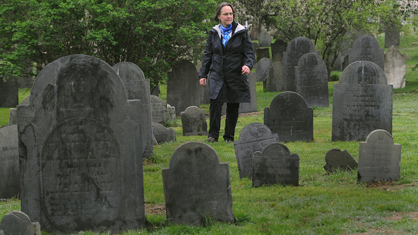 "Salem:<br /> Patricia Newhall won an honorable mention in the Salem News spring poetry contest for her poem: ""No More Does Ice Wind Bite, Thoughts in the Broad Street Cemetery in Spring"". She is walking through the Broad Street Cemetery on Wednesday morning..<br /> Photo by Ken Yuszkus/Salem News, Wednesday, May 11, 2011."