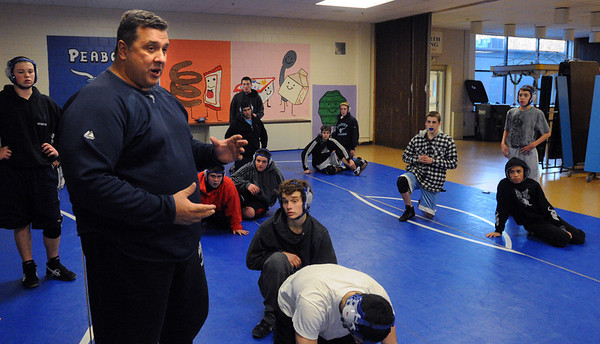 Peaody:<br /> David Henrick, Peabody High wrestling coach, speaks to the wrestlers at the practice in the school's cafeteria.<br /> Photo by Ken Yuszkus/Salem News, Thursday,  December 9, 2010.