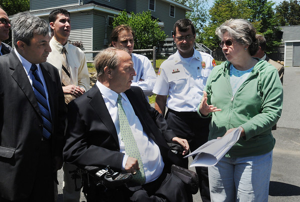 Danvers:<br /> From left, Danvers Rep. Ted Speliotis and Senator Thomas P. Kennedy listen to resident Janet Lettich speak about the damaage to her home. The group is on Bates Street as they tour the neighborhood affected by the Danversport explosion.<br /> Photo by Ken Yuszkus/Salem News, Monday, June 6, 2011.