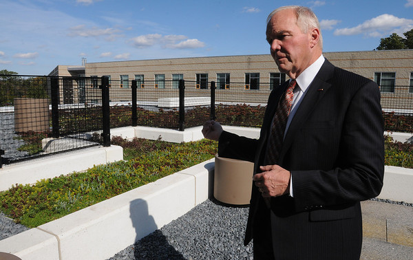 Danvers:<br /> Wayne Burton, president of the North Shore Community College, is standing on the living green roof of the new Health Professions and Student Services Building. It is the state's first  Zero Net Energy Building.<br /> Photo by Ken Yuszkus/Salem News, Monday, October 17, 2011.