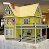 Peabody:<br /> Peter Jalbert built a dollhouse over 3 months with help from a woman, Earline Martin. The dollhouse is up for auction at Brooksby Village.<br /> Photo by Ken Yuszkus/The Salem News, Tuesday, August 21, 2012.