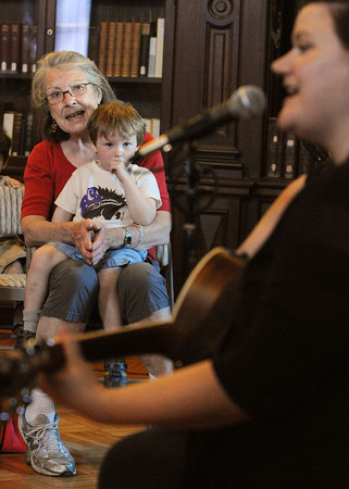 Peabody:<br /> Brenda Marean, nanny to Quinn Makary, 33 months old, who is on her lap, sing songs with singer/song writer Charlie Hope, right, at the Peabody Institute Library Tuesday morning.<br /> Photo by Ken Yuszkus/Salem News, Tuesday, April 17, 2012.