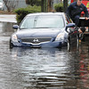 Peabody:<br /> Tow truck operators prepare to remove one of the two abandoned cars that were stranded in the high water on Railroad Avenue created by the heavy rainfall.<br /> Photo by Ken Yuszkus/Salem News, Wednesday, March 31, 2010.