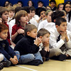 Peabody:<br /> Students listen to Tim Thomas, the Bruins' goalie and one of the goalies for the USA Olympic Team, speak during the send off at the Covenant Christian school.<br /> Photo by Ken Yuszkus/Salem News, Wednesday, February 3, 2010.