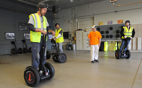 Salem:<br /> From left, Rick Buchanan of Peabody, John Greener of Salem, gets instructions on how to use a Segway from Jeff Langone, one of the co-owners, and listening also is Doug Merrill of Beverly. The practice trial and instruction is inside the Witch City Segways building.<br /> Photo by Ken Yuszkus/Salem News, Monday, May 9, 2011.