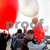 Salem:<br /> Rashad Sims, from the Beverly football team, ties a balloon to the rail at the middle of the Veterans Memorial Bridge at the beginning of the Bridging the Gap ceremonies. Students from both Salem and Beverly tied balloons to the rail at the Salem/Beverly town line.<br /> Photo by Ken Yuszkus/Salem News, Monday November 24, 2008.