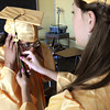 Peabody:<br /> Kristina Capo, left, gets help with her tassle from Jenna Connolly as they get ready for their graduation at Bishop Fenwick.<br /> Photo by Ken Yuszkus/Salem News, Friday, May 28, 2010
